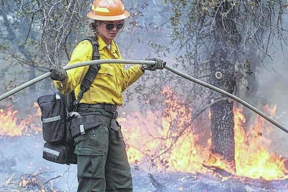 Brooke Hagarty helps with hoses while fighting the wild fires in Arizona at the end of June. Photo: Photo Provided