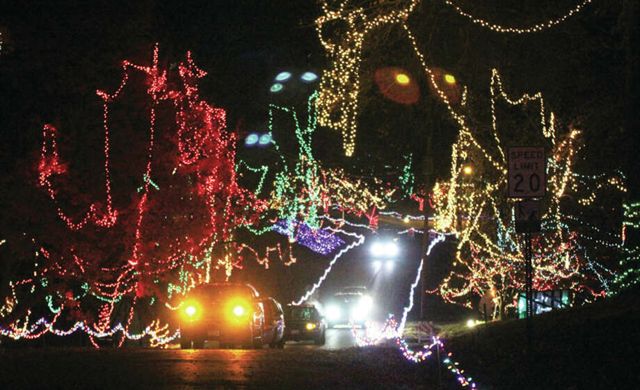 A line of vehicles make their way toward the exit of Christmas Wonderland in Rock Spring Park Saturday evening. The annual light display opened Friday, and will continue through Dec. 27. Volunteers at the park said about 350 vehicles came through Saturday night. Photo: Scott Cousins/The Telegraph
