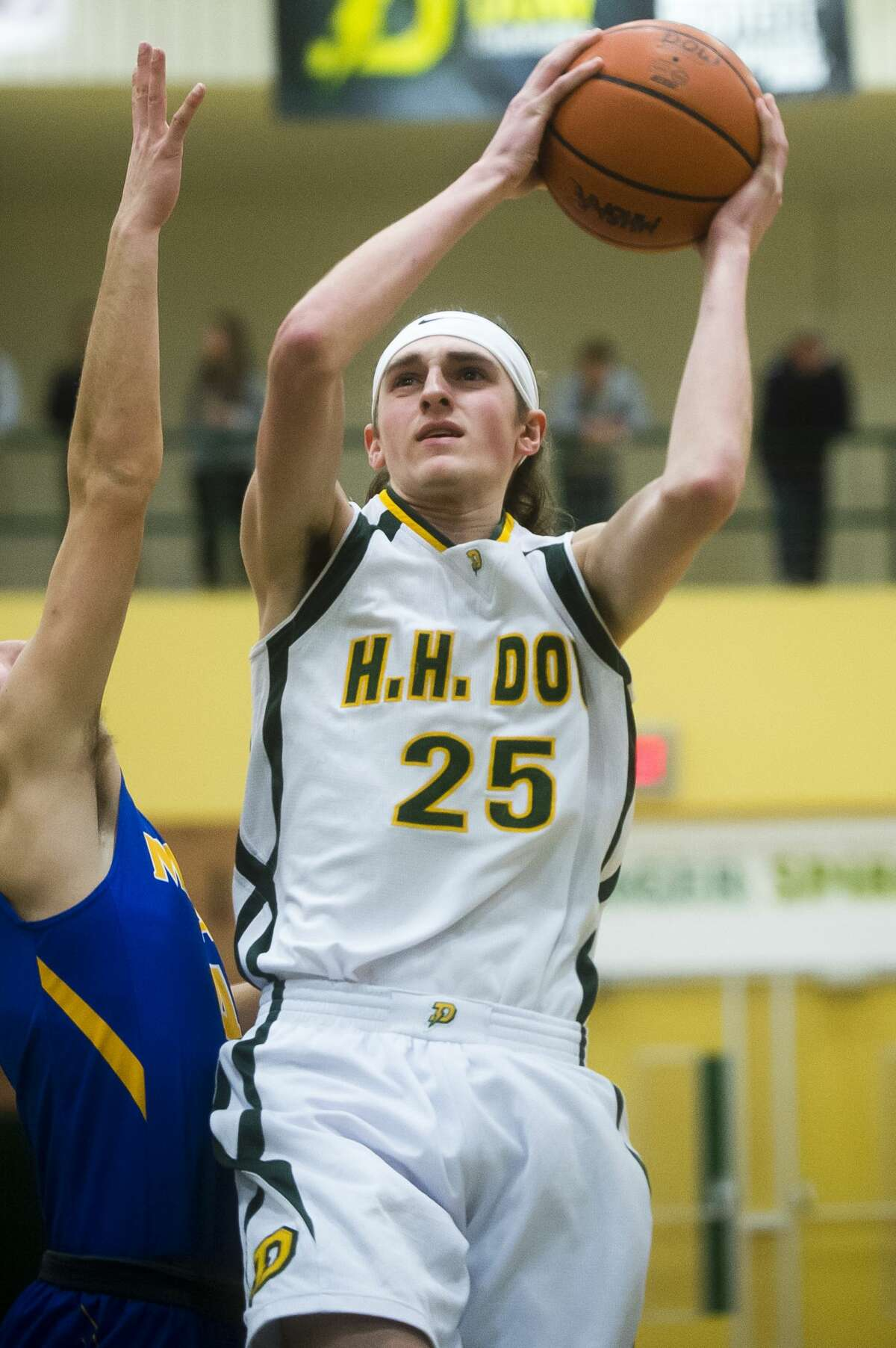 Dow senior Zac Chichester takes a shot during the Chargers' game against Midland on Friday, Feb. 9, 2018 at H. H. Dow High School. (Katy Kildee/kkildee@mdn.net)
