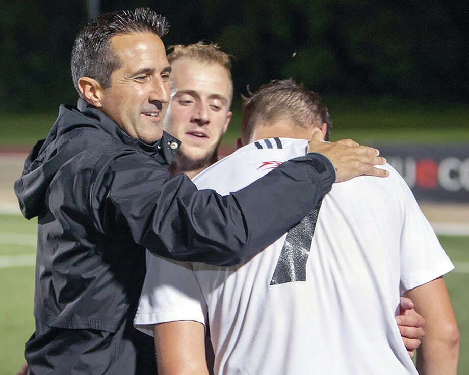 SIUE soccer coach Mario Sanchez, left celebrates a victory this season with Greg Solway, center, and Lachlan McLean. Photo: SIUE Athletics