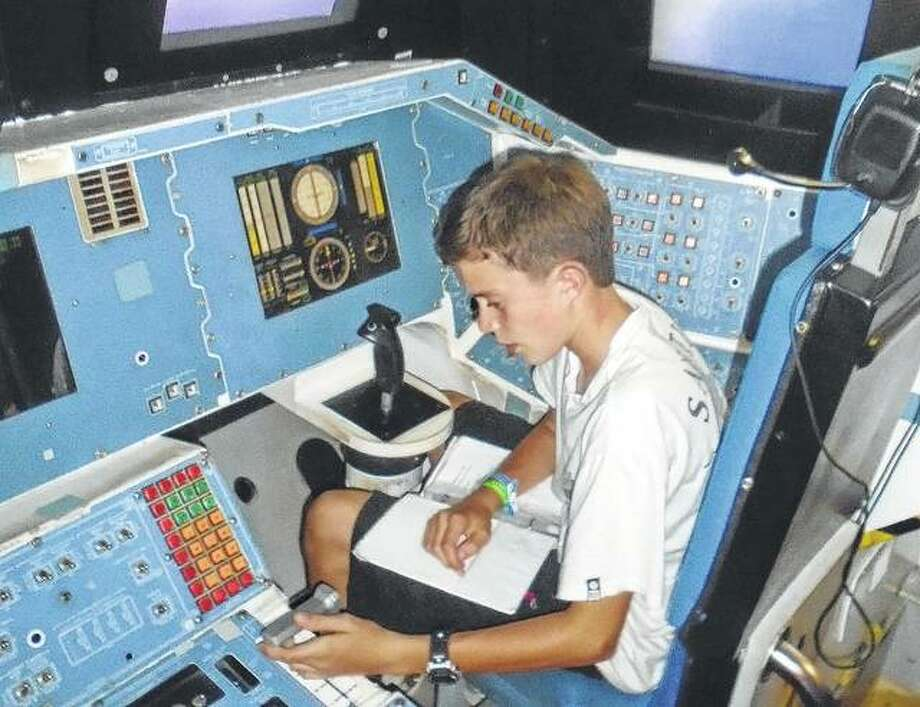Spencer Rouland of Jacksonville reviews his flight plan for a simulated shuttle launch at the U.S. Space and Rocket Center Space Camp in Huntsville, Alabama. Photo: Photo Provided