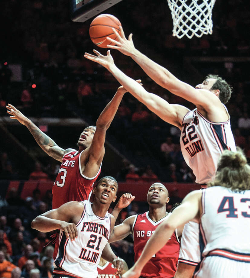 Illinois' Maverick Morgan (22) and North Carolina State's Ted Kapita (23) vie for the ball under the net as Illinois' Malcolm Hill (21) and North Carolina State's Torin Dorn (2) watch during the second half Tuesday night in Champaign. Photo: Associated Press