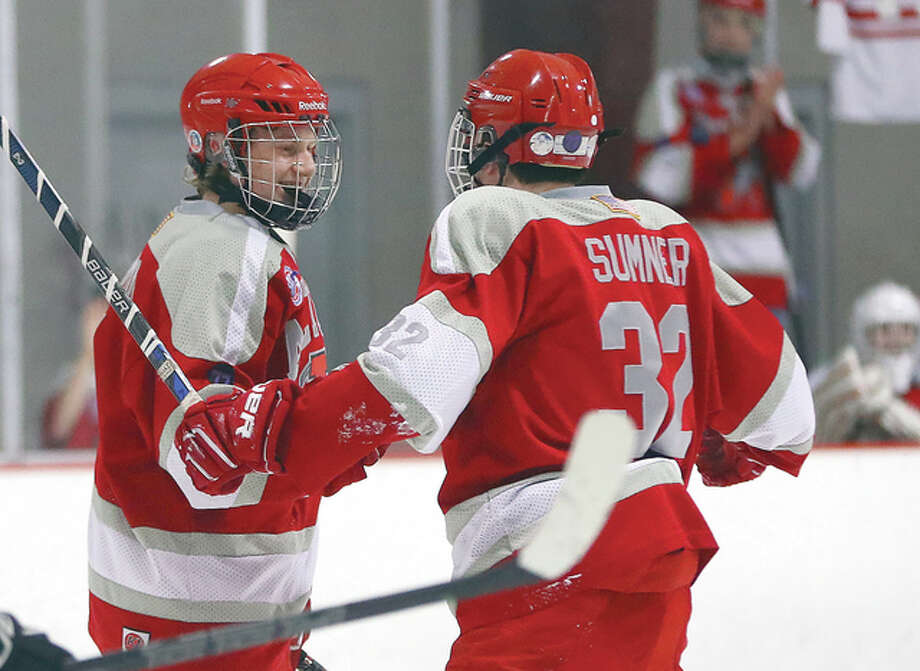Alton's Bryce Simon, left, scored all four of his team's goals in Tuesday night's 4-4 tie with rival Edwardsville at the East Alton Ice Arena. He is shown celebrating a goal with teammate Jack Sumner earlier this season in a game against Bethalto. Photo: Billy Hurst File Photo | For The Telegraph