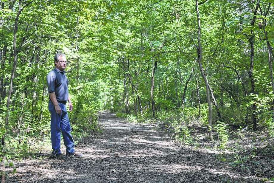 Jacksonville Parks and Lakes Department Director Kelly Hall stands on one of the new hiking trails that was dedicated Tuesday on the south side of Lake Jacksonville. Photo: Greg Olson | Journal-Courier