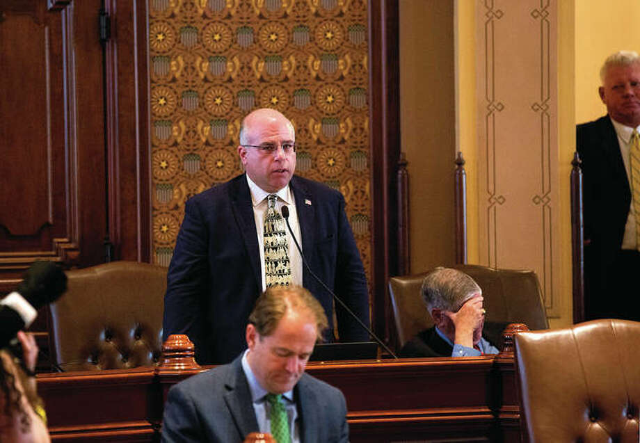 Sen. Sam McCann, R-Plainview, speaks on the Senate floor at the Capitol on Sunday. McCann was the only Republican senator to vote with Democrats to override Gov. Bruce Rauner's amendatory veto of Senate Bill 1, the education funding reform bill. The House now considers the measure.