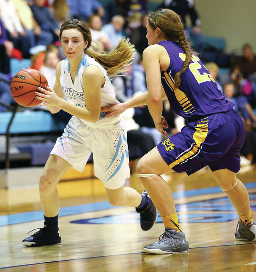 Jersey's Mackenzie Thurston (left), shown handling the basketball while defended by Civic Memorial's Allie Troeckler, is averaging 18.2 points per game in the Panthers' 3-2 start. Photo: Billy Hurst | For The Telegraph