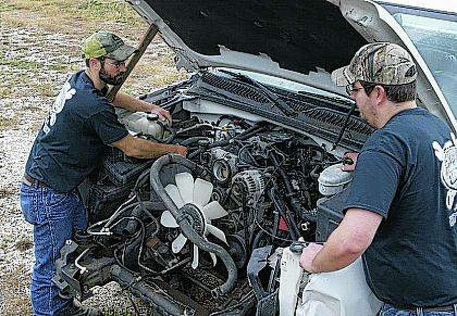Brian DeWitt (left) and Matt DeWitt have opened DeWitt Bros. Garage, an auto repair shop, at 909 S. Main St. Photo: Greg Olson | Journal-Courier