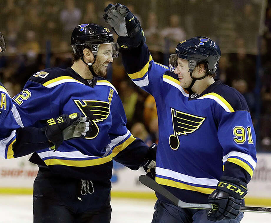 The Blues' Kevin Shattenkirk, left, is congratulated by Vladimir Tarasenko after scoring Thursday night against the Tampa Bay Lightning in St. Louis. Photo: Jeff Roberson | AP