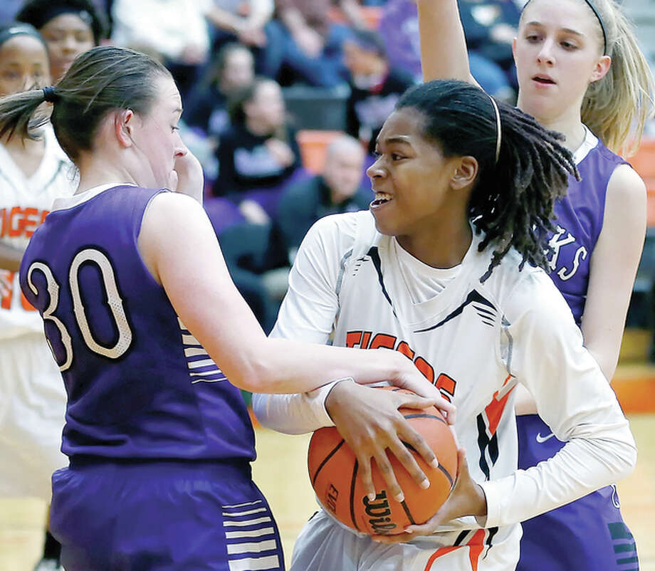 Edwardsville's Antionette Buehne tries to get past Collinsville's Criste'on Waters (25) in girls prep basketball action Thursday night in Edwardsville. Scott Kane | For The Telegraph