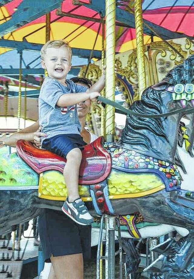 Ryker Foster of Jacksonville enjoys a ride on the carousel at the Illinois State Fair in Springfield. Photo: Kathy Caruthers | Reader Photo