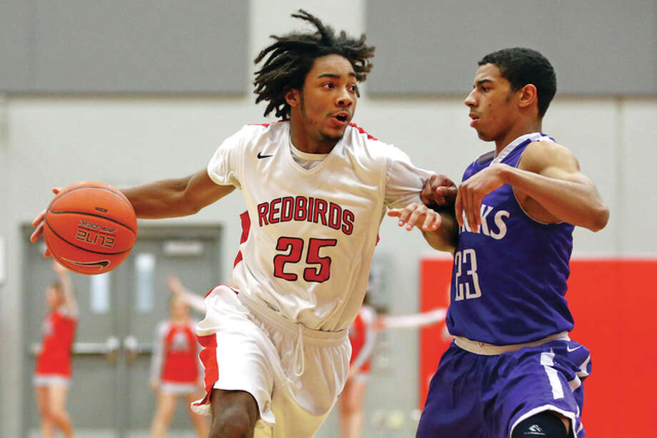 Alton's Maurice Edwards drives to the basket in a a game lasts season against Collinsville's Anfirnee Wilkinson. Edwards is averaging 19 points per game for the 2-1 Redbirds, who will play Granite City at 3:30 p.m. Saturday at SIUE's Vadalabene Center. Photo: Billy Hurst File Photo | For The Telegraph