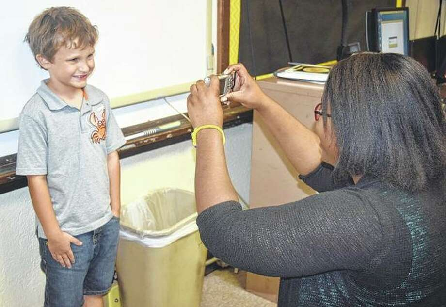 First-year teacher Angel Ewing takes a picture of student Dayton Ankle for the class board. Photo: Samantha McDaniel-Ogletree | Journal-Courier