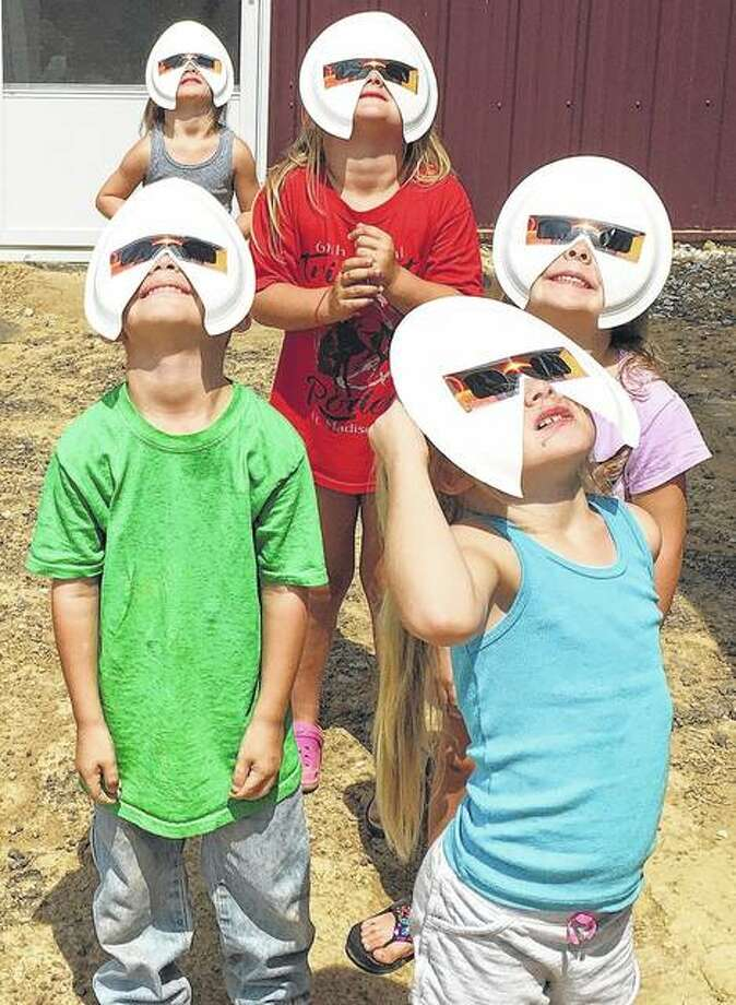 A group of 4- and 5-year-olds safely view the solar eclipse Monday near Waverly. Photo: Amy Clevenger | Reader Photo