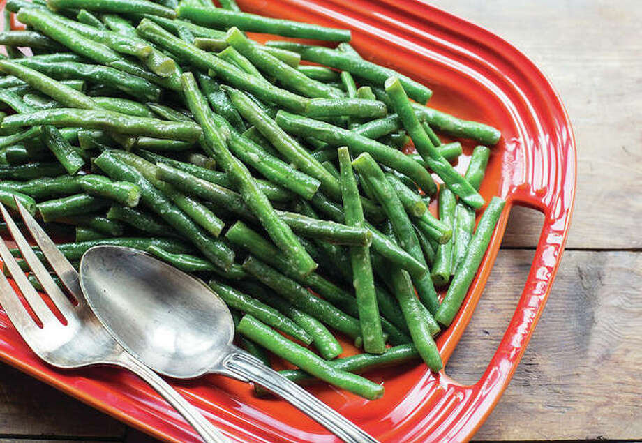 Honey Creole mustard green beans are one way to work through the hill — or mountain — of green beans available at this time of year. Photo: Sarah Crowder | Associated Press