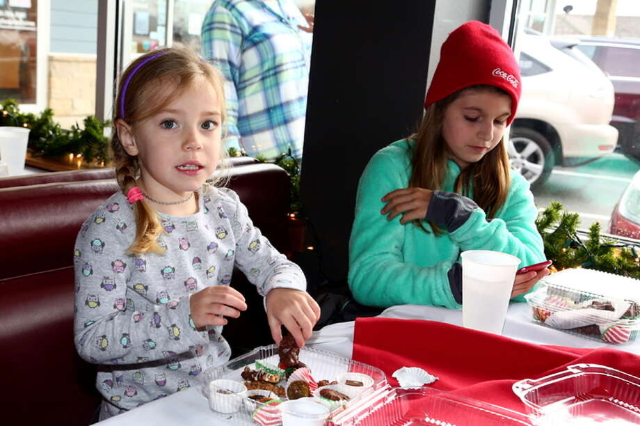 Two girls enjoy some cookies and other treats at Saturday's Taste of Chocolate event at Grafton Winery in Grafton.