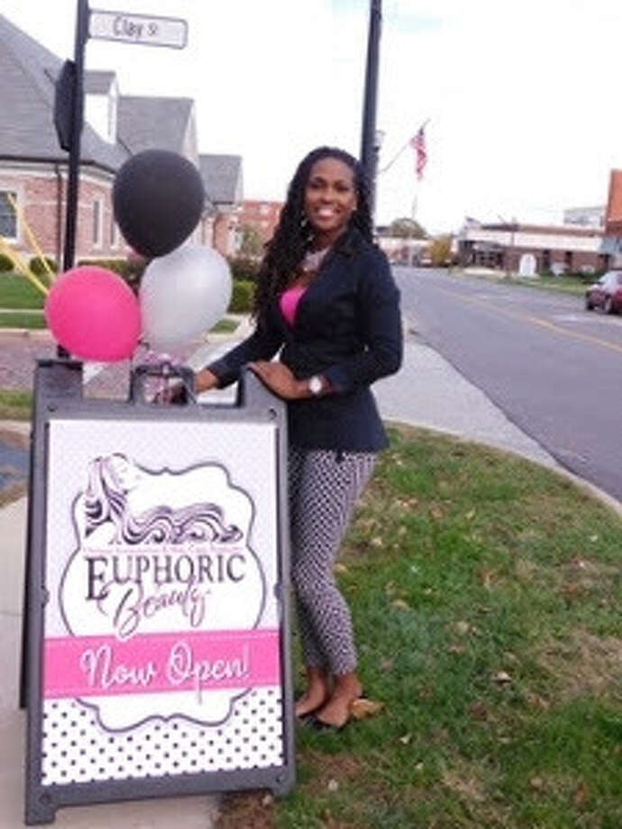 Markia Ivy outside her new Edwardsville accessory and hair care product boutique Euphoric Beauty.