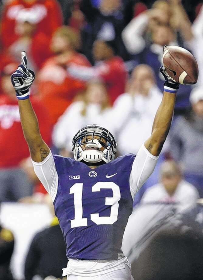 Penn State's Saeed Blacknall (13) celebrates making a 40-yard touchdown reception during the first half of the Big Ten championship NCAA college football game against Wisconsin. Photo: AP