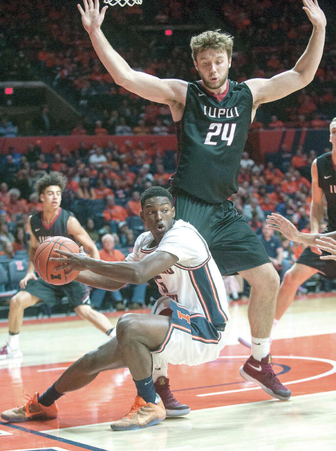 Illinois guard Jalen Coleman-Lands (5) slips on a drive to the basket near IUPUI forward Evan Hall (24) Tuesday night in Champaign. Photo: AP