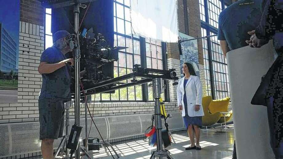 Elizabeth Watkins Clary, a 1997 graduate of Jacksonville High School, works on a televison commercial for SmarthMouth mouthwash.
