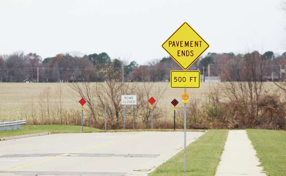 The Lars Hoffman Crossing in Godfrey got a boost Tuesday when the village board approved a resolution to extend the road another 1,000 feet. The board also approved hiring a firm to study the idea of a second business district along the road.