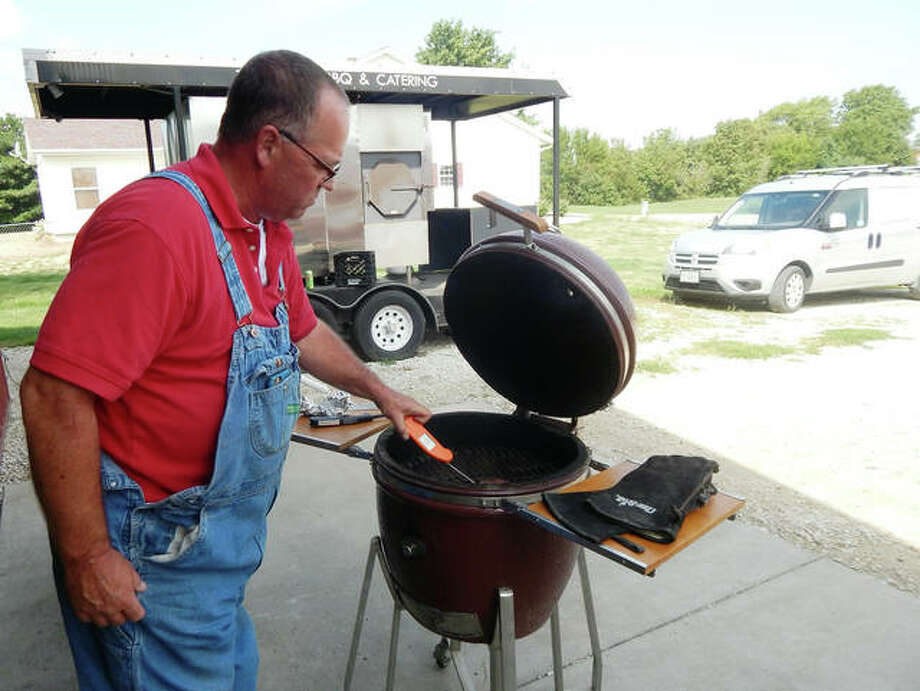 Randy Twyford of Twyford BBQ & Catering uses a digital thermometer Monday to check the temperature of a sirloin steak he's grilling. Photo: Photos By Angela Bauer | Journal-Courier