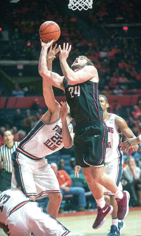 IUPUI forward Evan Hall (24) is fouled by Illinois center Maverick Morgan (22) during the second half of an NCAA college basketball game in Champaign, Ill., Tuesday, Dec. 6, 2016. (AP Photo/Rick Danzl)