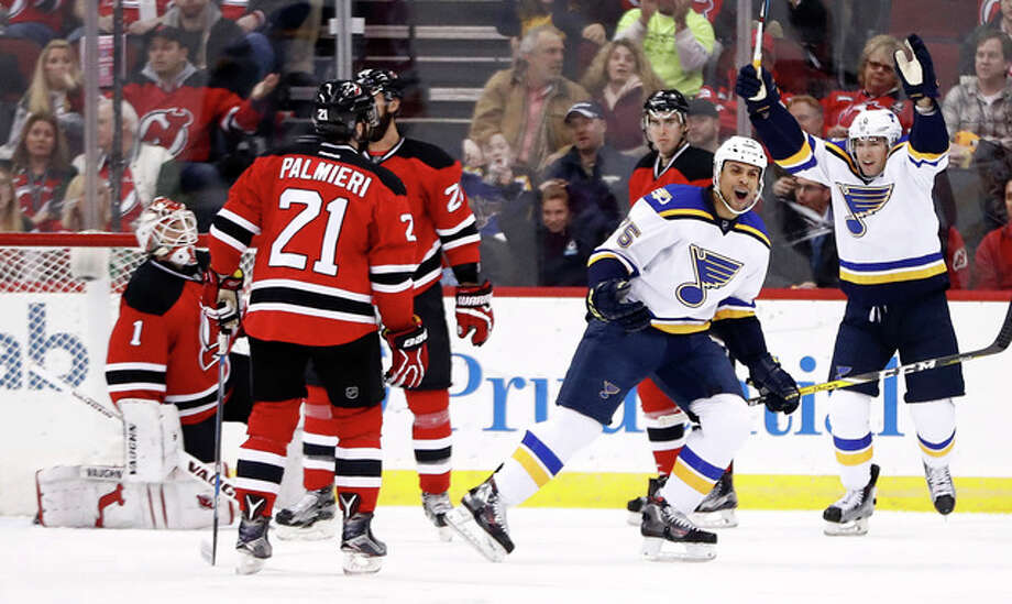 Blues right wing Ryan Reaves, center, celebrates after scoring a goal on New Jersey Devils goalie Keith Kinkaid (1) Friday in Newark, N.J. Photo: AP