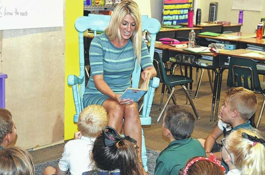 The students in Jess Brown's third grade class at Our Saviour School listen as she reads a book Wednesday. Photo: Samantha McDaniel-Ogletree | Journal-Courier