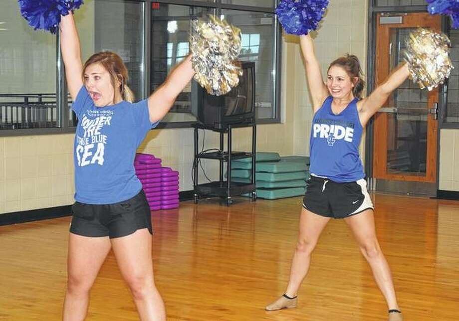 Haley Holtzman (front), a sophomore at Illinois College, and Chauntel Vance, a junior, practice with the Illinois College dance team on Thursday. Photo: Samantha McDaniel-Ogletree | Journal-Courier