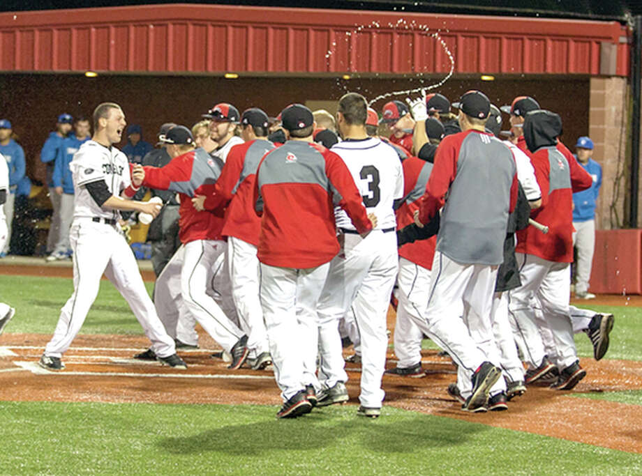 SIUE baseball players celebrate a walkoff home victory last season. On Monday, the Cougars announced their 2017 schedule, which includes 23 home contests. Photo: SIUE Athletics