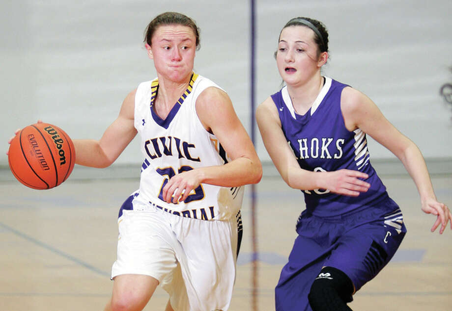CM's Allie Troeckler (23) pushes past Collinsville's Kaitlyn Fischer Monday night in Bethalto. Troeckler scored 25 points in the Eagles' 68-37 win and broke Katie Broadway's school career scoring record of 2,079 points set in 2008. Troeckler has 2,090 career points. Photo: James B. Ritter | For The Telegraph