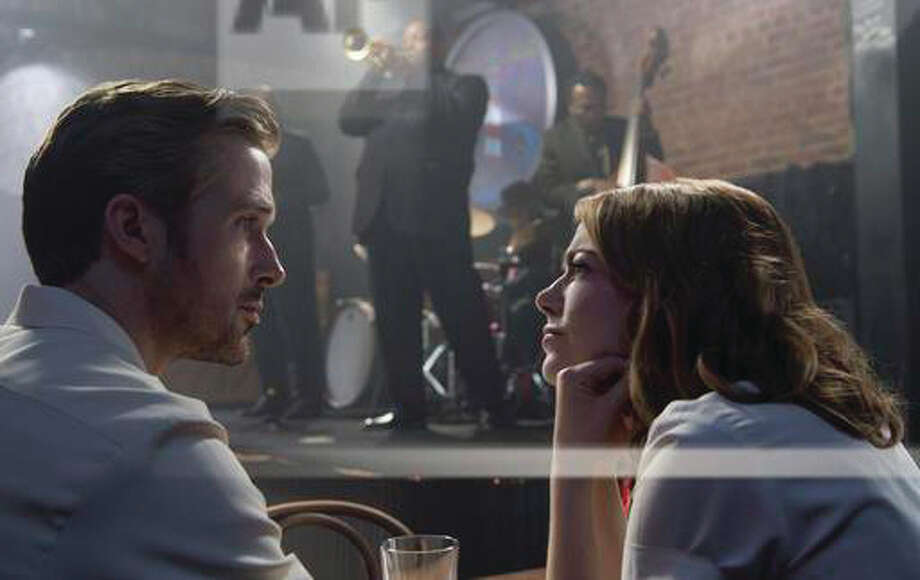 "This image released by Lionsgate shows Ryan Gosling, left, and Emma Stone in a scene from ""La La Land."" The film was nominated for a Golden Globe award for best motion picture musical or comedy on Monday. The 74th Golden Globe Awards ceremony will be broadcast Jan. 8 on NBC. (Dale Robinette/Lionsgate via AP)"