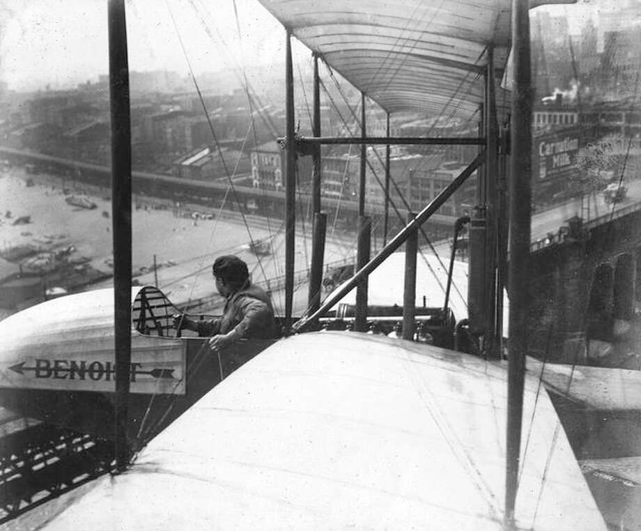 "Photo courtesy of Missouri History Museum|For The Telegraph From ""The Aerial Crossroads of America,"" Tony Janus flying over the Eads Bridge."