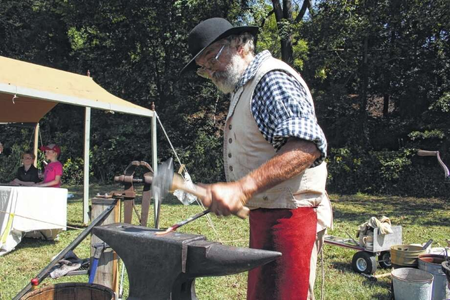 A blacksmith explains his craft with demonstrations.