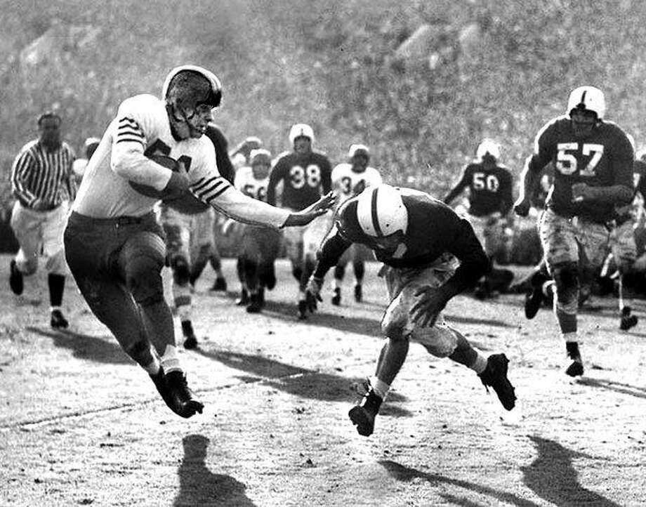 Illinois runner Art Dufelmeier tries to elude UCLA's Al Hoisch during the 1947 Rose Bowl game in Pasadena, California. UCLA was favored by as many as three touchdowns, but Illinois won 45-14. For many years, only the Big Ten allowed just one team to go to a bowl game and that game was the Rose Bowl. The conference also at one time did not allow any second-year repeat appearances Photo: Rose Bowl File Photo