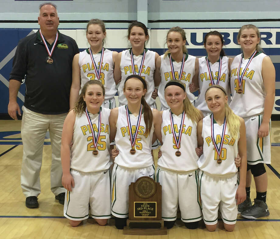 The Southwestern Middle School seventh-grade girls basketball team capped a 25-1 season with a third-place finish at the IESA Class 3A state tournament at Auburn. The Piasa Birds, who got a team-high 10.7 points per game in the tourney from Addison Green, defeated Steger Columbia 28-9 in a quarterfinal game. The Birds lost to eventual runner-up Farmington Central 29-21 in the semifinals before bouncing back to beat Riverton 17-12 for third place. The Birds, shown with their third-place trophy, include (front row, from left) Whitney Keith, Hannah Nixon, Addison Green, Morgan Durham, (back row, from left) coach Steve Wooley, Madyson Heffington, Cami Bolin, Haley Daniels, Ashlyn Darr and Callie Stormer. Photo: Submitted Photo