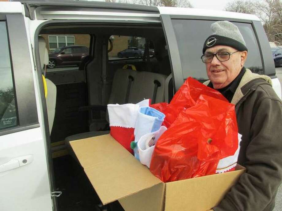 A Meals on Wheels driver packs up stockings to deliver to area clients.