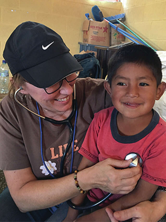 For The Telegraph Southern Illinois University Edwardsville School of Nursing's Deborah Horton provides care to a young boy during a medical mission trip in Guatemala. Photo: For The Telegraph