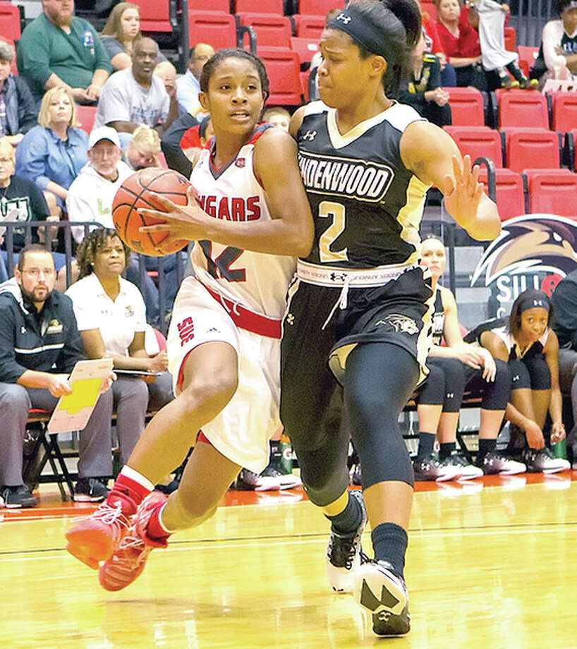 SIUE's Lauren white, left, scored 20 points in her teams 97-78 loss to Northern Illinois University Friday night in DeKalb. she is shown in action earlier this season against Lindenwood. Photo: SIUE Athletics