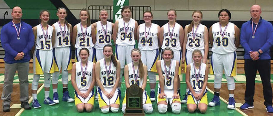 The Bethalto Trimpe Middle School eighth-grade girls basketball team capped a 26-2 season with a second-place finish at the IESA Class 4A state tournament Thursday in Macon. The Royals defeated Pekin Broadmoor 38-31 in the quarterfinals and Homer Glen Homer 37-27 in the semifinals. Charleston finished its 22-0 season by defeating Trimpe 44-37 in the championship game. The Royals posing with their state runner-up trophy are (back row, from left) coach Jeff Ochs, Azia Ray, Hannah Sontag, Addie Callies, Danielle Massey, Jackalynn Woelfel, Chloe Gleason, Emily Williams, Ally Hardy, Riley Betts, assistant coach Jeff Durbin, (front row, from left) Raegan Bechel, Hannah Butchkovich, Tori Standefer, Harper Buhs and Kelbie Zupan. Photo: Submitted Photo