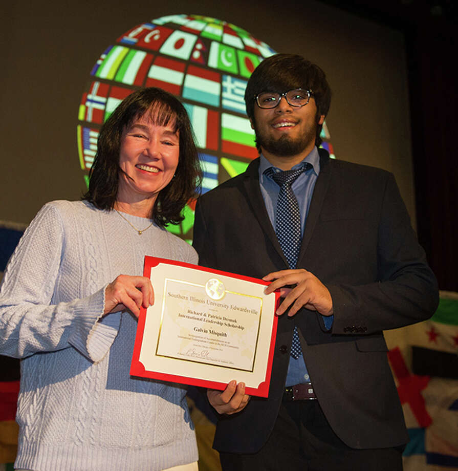 Mary Weishaar, executive director of the Office of International Affairs, presents a scholarship award to Southern Illinois University Edwardsville's Galvin Misquith of Karnataka, India. Photo: For The Telegraph