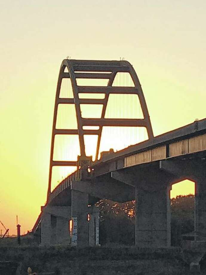 The sun sets through the Meredosia Bridge. Photo: Joy Harris | Reader Photo