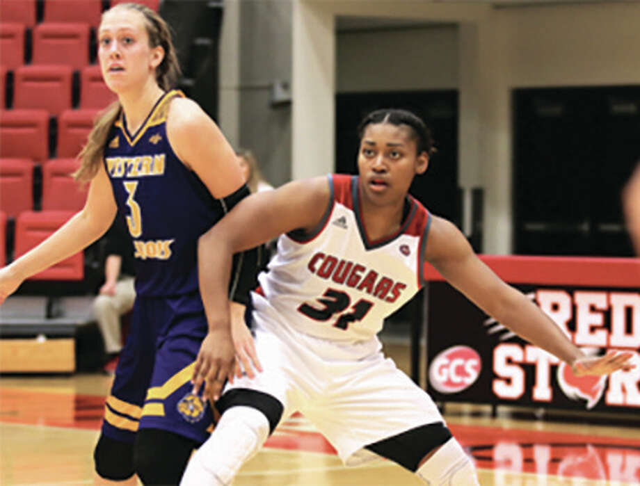 SIUE's Donshel Beck (right), shown working for position on Western Illinois' Olivia Braun in a Nov. 27 game at Vadalabene Center in Edwardsville, scored a game-high 27 points in the Cougars' 78-68 loss to host Stetson on Monday at the 29th annual Hatter Classic in DeLand, Fla. Photo: SIUE Athletics