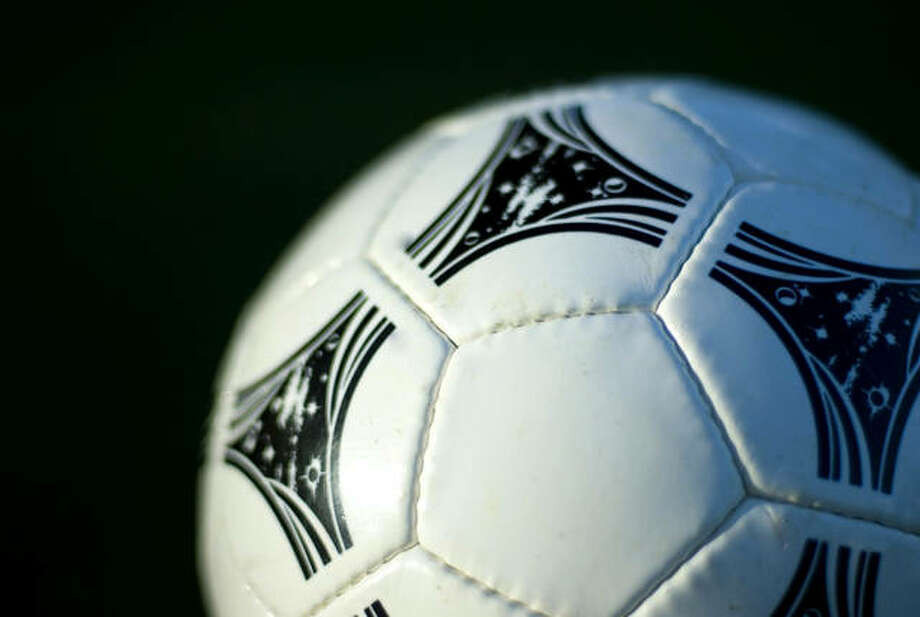 close up on a white leather soccer ball