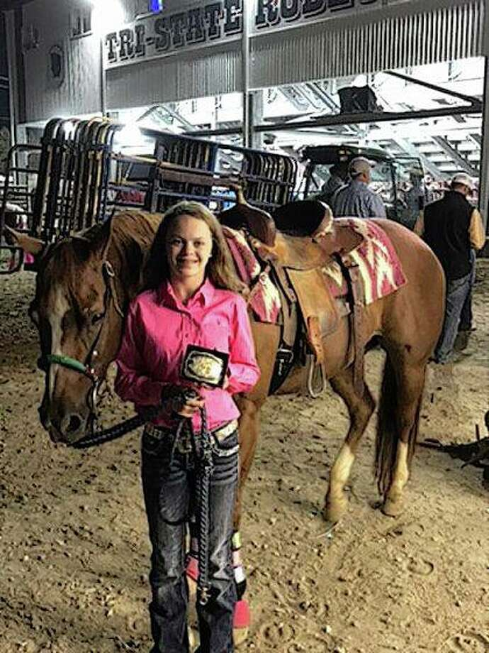 Emma Brown of Winchester finished fourth out of 26 participants in the qualifying round of the Pee-wee Barrels at the Tri-State Rodeo in Fort Madison, Iowa, and sixth overall at the rodeo. She is the daughter of Tim and Shelia Brown. Photo: Photo | Jina Simons