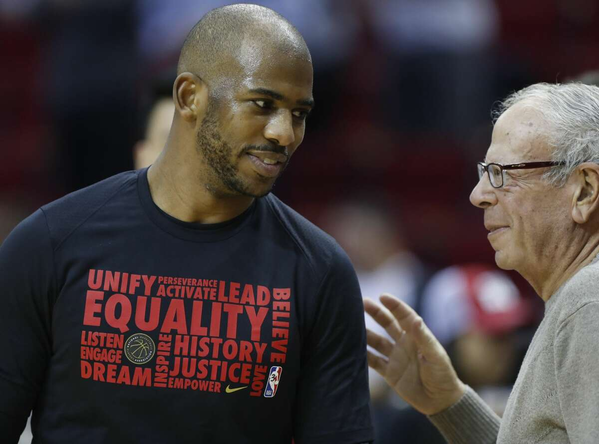 Houston Rockets guard Chris Paul (3) chats with former owner Les Alexander before the start of the first half of an NBA bassketball game at Toyota Center, Friday, Feb. 9, 2018, in Houston. ( Karen Warren / Houston Chronicle )