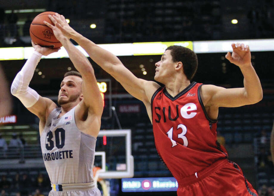 SIUE's Christian Ellis (right) contests a shot by Marquette's Andrew Rousey during their men's college basketball game Wednesday night in Milwaukee, Wisconsin. Photo: Marquette Athletics