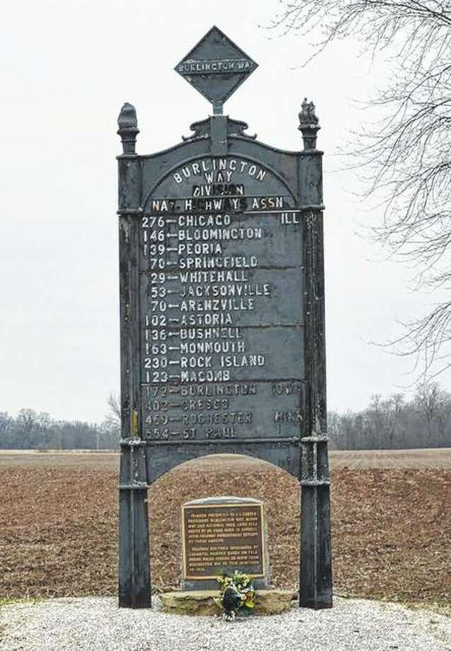 The Burlington Way motor route, established in the early part of the 20th century, has this reminder of its hey-day before being renamed the Mississippi Valley Highway in 1919. This 1,500-pound iron sign stands as a prominent and lonely reminder of the early days of automobile travel. Just east of the Greene County line near Kemper, the road marker shows the mileage travelers have left to reach 16 cities north of the point.