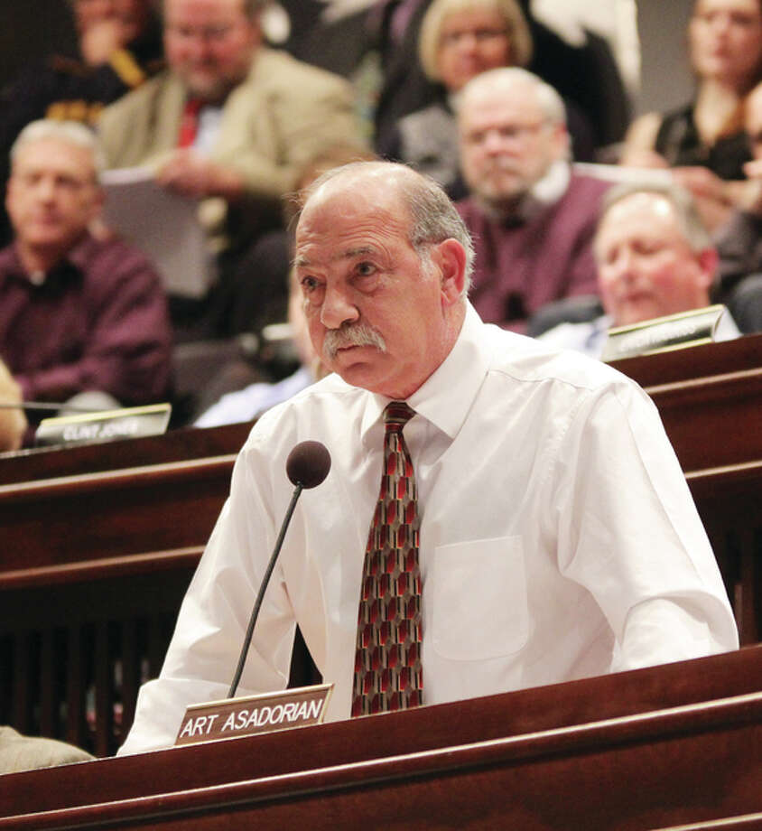 "Madison County Board Member Art Asadorian, D-Granite City, attempts to make a motion early in Wednesday's board meeting. He was not allowed to make the motion at that time, but later made a motion to call a special meeting to ""redo"" the council's actions since it's reorganizational meeting in early December, which was also overruled."