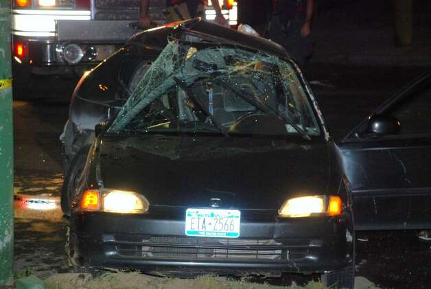 This car, driven by Melissa Escobar of Albany, was broadsided early Saturday morning by an Albany police patrol car at Quail Street and Madison Avenue, killing Escobar's passenger. Neither the police officer nor the victim had been identified as of Saturday afternoon. (Tom Heffernan Sr./Special to the Times Union)